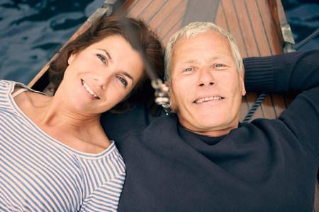 Middle aged couple on boat (portrait) Banco de Imagens - 113894949