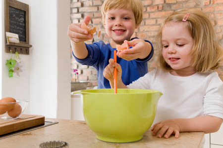 girl and boy mixing ingredients