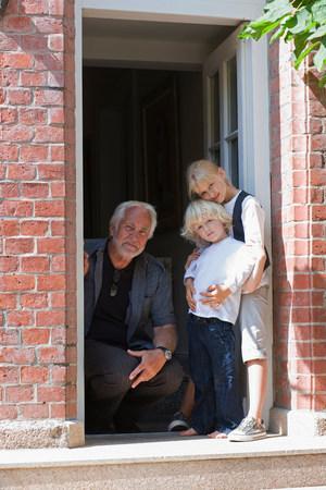grandfather and grandchildren waiting