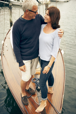 Middle aged couple on an old boat Banco de Imagens - 114014412