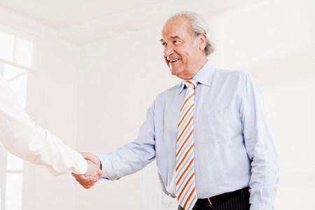 Senior executive shaking hands