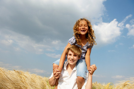 Brother and sister in a wheat field