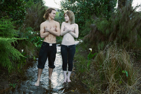 Young couple standing in stream