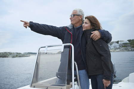 Middle aged couple on motor boat Banco de Imagens