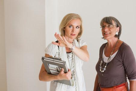 two businesswomen having a conversation Stock Photo
