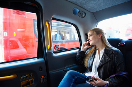 Woman on the phone, in taxi