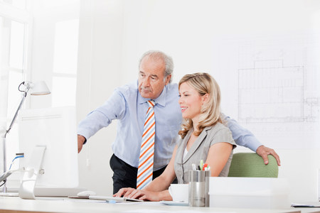 Senior and co-worker at a computer Stock Photo