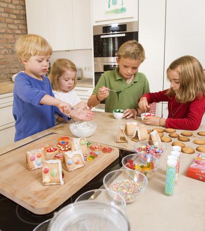 four kids baking cookies