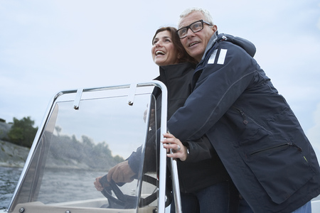 Middle aged couple on motor boat Banco de Imagens - 114016105