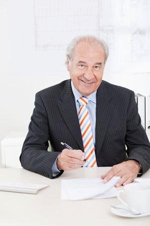 Senior executive signing document