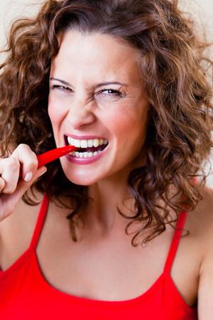 Woman Biting Chili