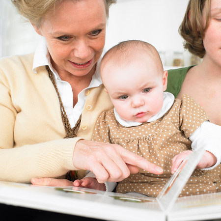 grandmother and baby reading book 写真素材