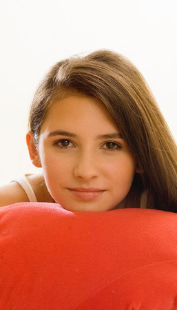 girl with chin on cushion