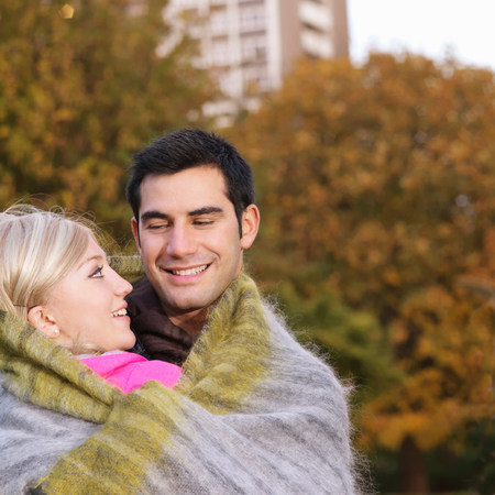 couple wrapped in blanket Stock Photo