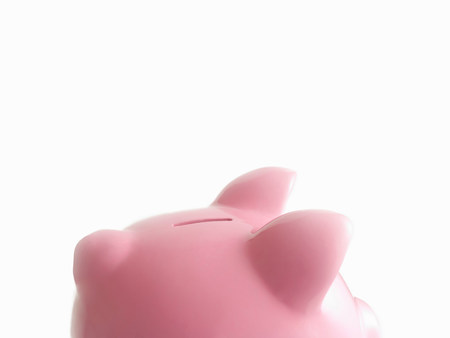 Piggy bank against white Stock Photo