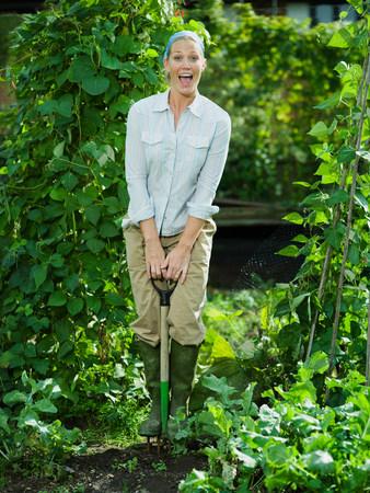 Young female working in a garden Archivio Fotografico
