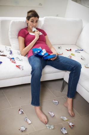 girl addicted to chocolate bars Stockfoto