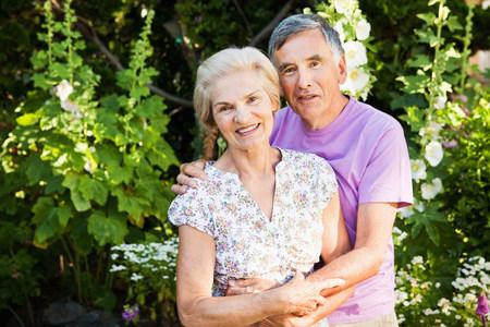 portrait of  mature couple in garden.