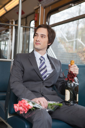 businessman in tube, champagne, flowers Imagens