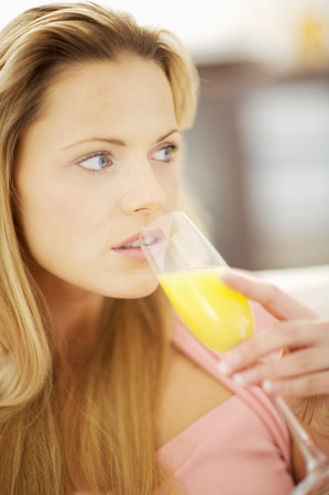 woman drinking orange juice Archivio Fotografico
