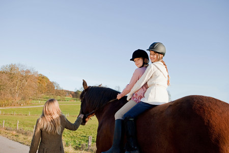Two girls on a horseback