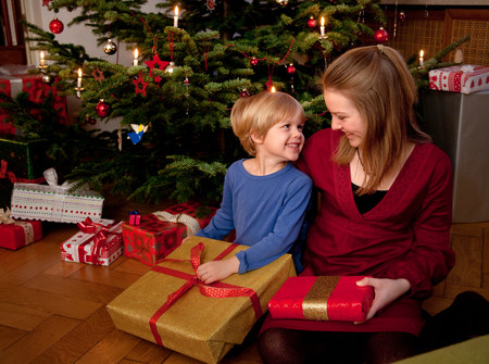 boy and girl with christmas presents