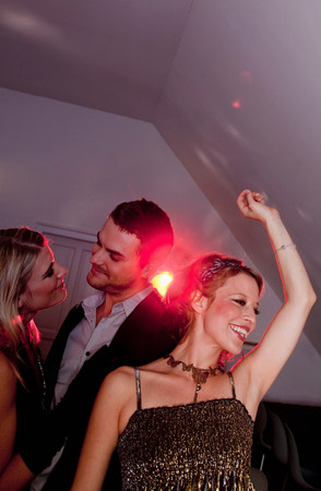 two women and a man dancing
