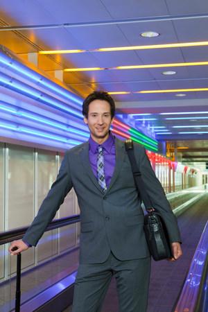 business man on conveyor belt, happy Фото со стока