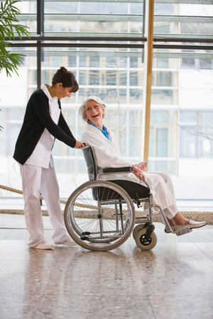 Old woman in a wheel chair and nurse