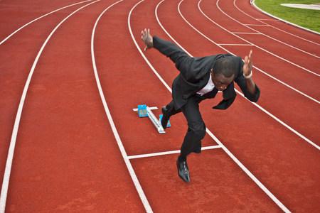 businessman sprinting on running track