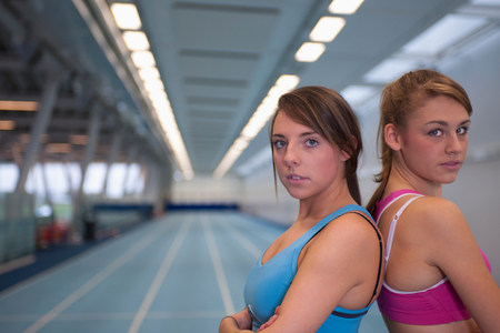 2 female athletes looking to camera