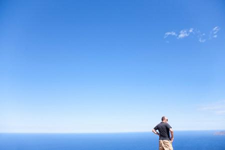 Man in front of ocean