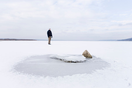 Man on frozen lake