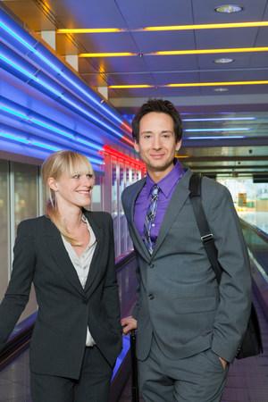 business couple on conveyor belt Фото со стока