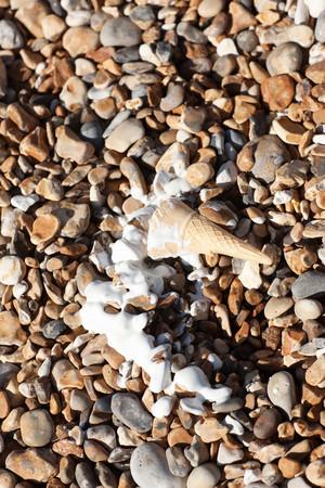 Melted ice-cream on beach