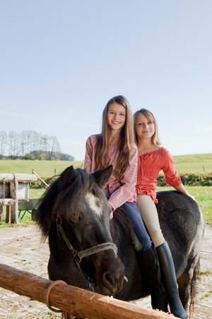 Two girls on horseback Reklamní fotografie