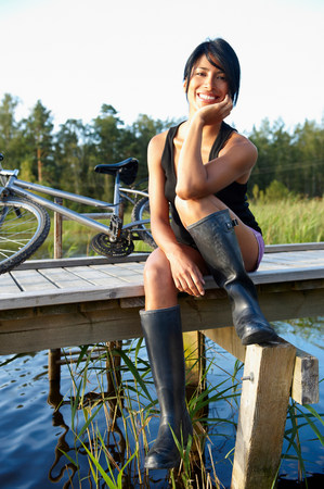 Woman sitting on a dock, smiling