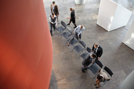 Group of business people with chairs Standard-Bild