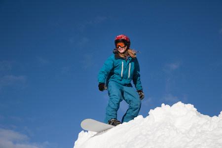 Girl snowboarding Reklamní fotografie