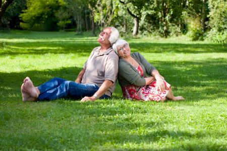 Grandparents relaxing in the garden