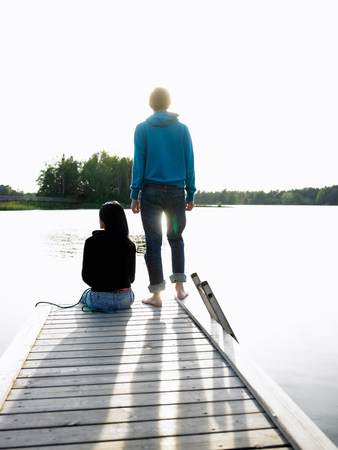 Couple at the end of a dock