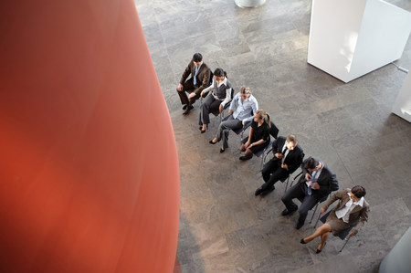 Group of business people sitting in line Stock Photo
