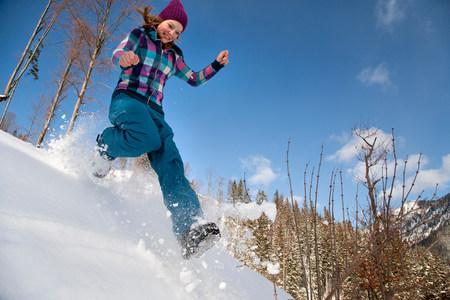 Girl jumping, running in snow Reklamní fotografie
