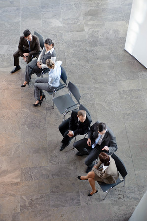 Two groups of business people discussing