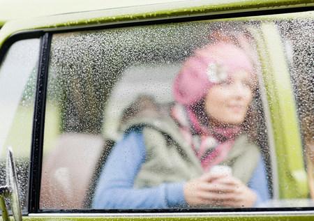 Woman looking out of camper van Imagens