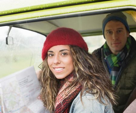 Couple in camper van looking at map