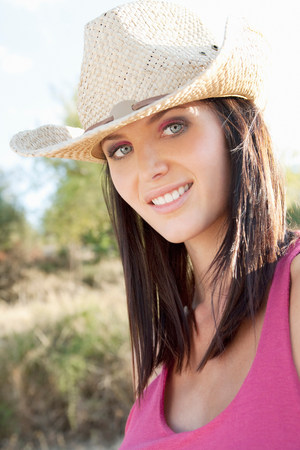 Portrait of a woman in a cowgirl hat