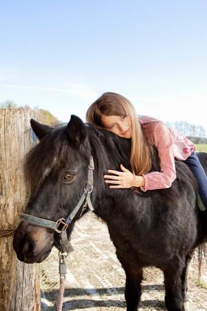 Girl on horseback Reklamní fotografie