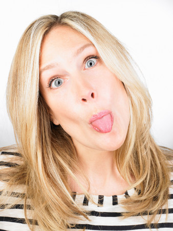 Woman sticking out her tongue Stock Photo