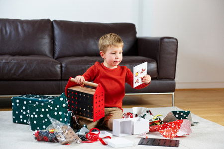 Young boy opening presents